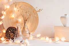 Christmas home decoration with lights on  white wooden background. Stock Photos