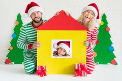 Christmas Home Holiday Design Concept. Happy child playing at home. Funny kid on Christmas eve. Xmas winter holiday concept Stock Images