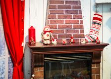 Fireplace and decorations on the mantelpiece. Christmas home interior decorations. Fireplace and decorations on the mantelpiece Royalty Free Stock Images
