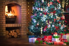 Christmas home interior with tree and fireplace stock photo