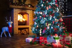 Christmas home interior with tree and fireplace Stock Images