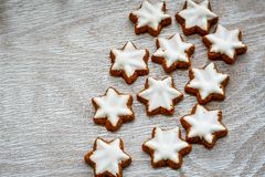 Christmas star cookies. Christmas home made cinnamon star cookies.and biscuit cutter , on white wooden background stock photos