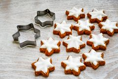 Christmas star cookies. Christmas home made star cookies.and biscuit cutter , on white wooden background stock photography