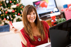 Christmas: Home Shopper with Credit Card Stock Photography