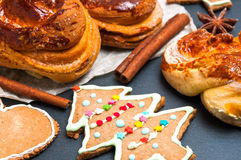 Christmas homemade baked products: pine-shape cookies, cinnamon buns and ingredients Stock Photography