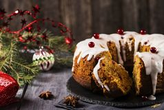 Christmas homemade cake with nuts, apples and cranberries with icing Royalty Free Stock Photos