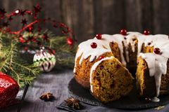 Christmas homemade cake with nuts, apples and cranberries with icing Royalty Free Stock Photo