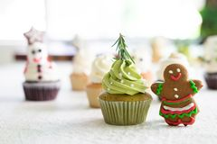 Christmas homemade cupcake and gingerbread cookies. Royalty Free Stock Image