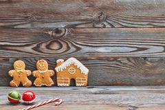Christmas homemade decoration, gingerbread house and couple - man and woman. Stock Image