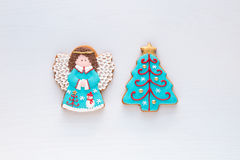 Christmas homemade gingerbread angel and christmas tree cookies Stock Photo