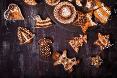 Christmas homemade gingerbread cookies on dark wooden table royalty free stock image