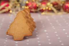 Christmas homemade gingerbread cookies on linen. With xmas lights stock photo