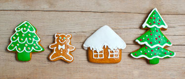 Christmas homemade gingerbread cookies over wooden Stock Photos