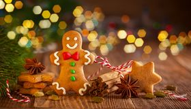 Christmas homemade gingerbread cookies a. Nd spices on the wooden background royalty free stock image