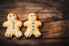 Christmas homemade gingerbread man cookie on wooden table. Chr Royalty Free Stock Photos