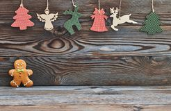 Christmas homemade gingerbread man on wooden background and decoration Royalty Free Stock Image
