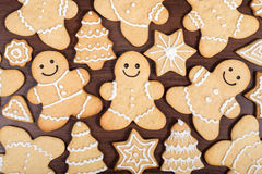 Christmas homemade gingerbread men, firs, stars cookies over wooden background Royalty Free Stock Images