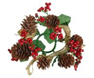 Christmas homemade New Years garland wreath from pine and fir tree cones, branches and red berries. Isolated on white stock photo