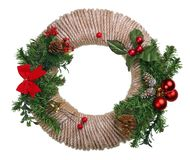 Christmas homemade New Years garland wreath from pine and fir tree cones, rope, branches and red berries isolated. Christmas royalty free stock images