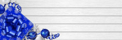 Christmas horizontal web banner on white wooden background. Horizontal Christmas web banner in blue colors with place for your text. Gift boxe, Christmas Stock Images