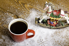 Christmas horse and red cup of coffee. Stock Photo