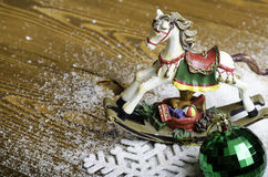 Christmas horse, snowflake and Christmas toy. Royalty Free Stock Image