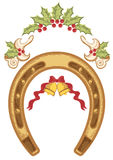 Christmas horseshoe with holly berry leaves. Isolated on white Stock Photo