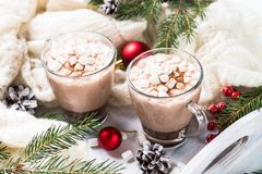Christmas hot chocolate or cocoa with marshmallow on white. Royalty Free Stock Image