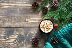 Christmas hot chocolate or cocoa with marshmallows on the wooden background and decor. Top view and copy space.