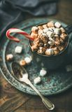 Christmas hot chocolate with marshmallows, cocoa and candy cane stock images