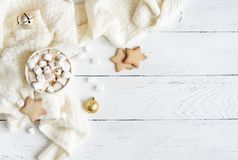 Christmas Hot Chocolate. With marshmallows in white mug, top view, copy space. Hot cocoa drink for Christmas and winter holidays with warm scarf, festive decor royalty free stock images