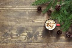 Christmas hot chocolate with marshmallows on the wooden background. Top view with copy space. Christmas hot chocolate with marshmallows on the wooden background royalty free stock photos