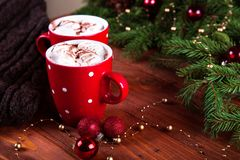 Christmas hot chocolate with marshmelow on a dark wooden background, christmas tree branches decorating. top view, horizontal comp Stock Images