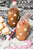 Christmas hot chocolate, sweet cookies  and colorful decorations Stock Photos