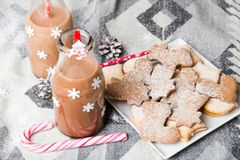 Christmas hot chocolate, sweet cookies  and colorful decorations Stock Photo