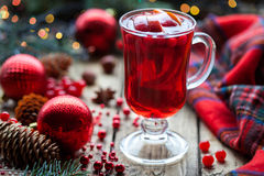 Christmas hot cranberry mulled wine, orange pomegranate punch or sangria. Closeup. Winter decorations. Stock Images