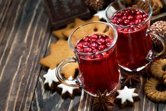 Christmas hot cranberry tea and cookies on dark background Stock Photography