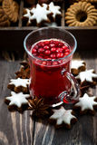 Christmas hot cranberry tea or mulled wine and assorted cookies Royalty Free Stock Photo
