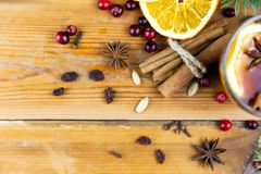 Christmas hot drink with cinnamon and spices on a wooden backgro royalty free stock images