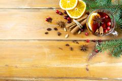 Christmas hot drink with cinnamon and spices on a wooden backgro stock photo
