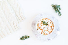 Christmas hot drink, coffee with small marshmallows, fir cones and branches. White table, top view, flat lay Royalty Free Stock Photography