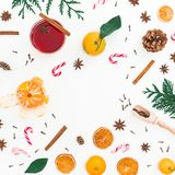 Christmas hot mulled wine with cinnamon, anise and candy cane on white background. Flat lay, top view Royalty Free Stock Images