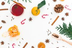 Christmas hot mulled wine with cinnamon, anise and candy cane on white background. Frame composition. Flat lay, top view Stock Photography