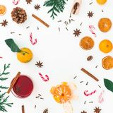 Christmas hot mulled wine with cinnamon, anise and candy cane on white background. Holidays composition, frame. Flat lay, top view Royalty Free Stock Photography