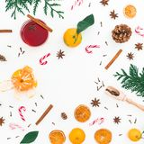 Christmas hot mulled wine with cinnamon, anise and candy canes on white background. Frame background. Flat lay, top view Stock Photography