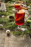 Christmas hot mulled wine with cinnamon, orange and christmas tree on board. Winter tradition drink. Christmas hot mulled wine with cinnamon, orange and Stock Photo