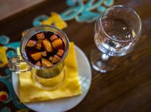 Christmas hot mulled wine with different fruits and spices, sel royalty free stock photography