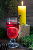 Christmas hot mulled wine and lighted candle Stock Images