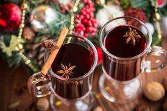 Christmas hot mulled wine with spices on a wooden table. Royalty Free Stock Photography
