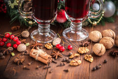 Christmas hot mulled wine with spices on a wooden table. Royalty Free Stock Photos